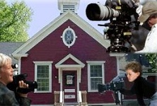 Camera People in Front of Red Schoolhouse
